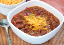 Bowl of Homemade Chili with Shredded Cheddar