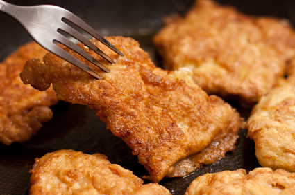 Ready fried chicken chops on griddle